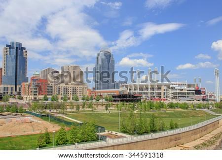 CINCINNATI, OHIO, USA - MAY 13, 2014: Skyline of Cincinnati with the Great American Ballpark Stadium - stock photo