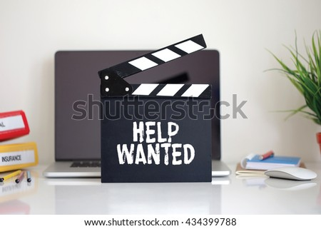 Cinema Clapper with Help Wanted word - stock photo