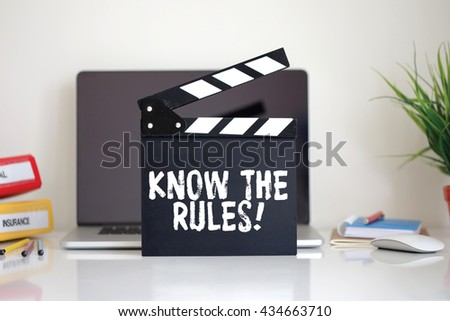 Cinema Clapper with Know The Rules! word - stock photo