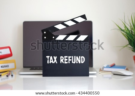 Cinema Clapper with Tax Refund word - stock photo