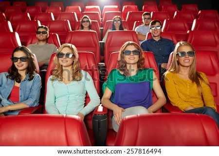 cinema, technology, entertainment and people concept - happy friends with 3d glasses watching movie in theater - stock photo