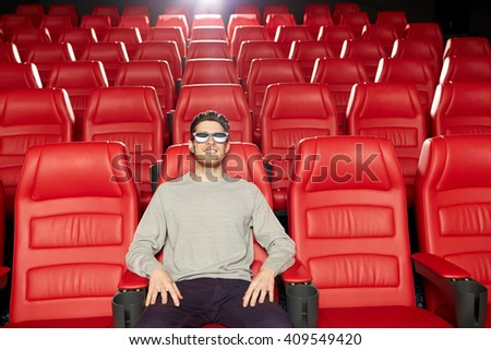 cinema, technology, entertainment and people concept - happy young man with 3d glasses watching movie alone in empty theater auditorium