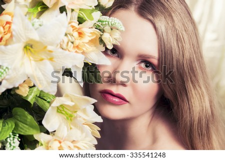 Cinematic portrait of a beautiful blonde woman with flowers all around her.