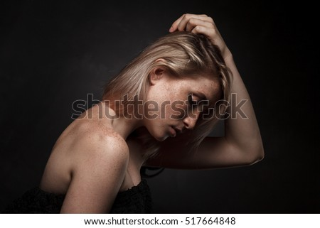 cinematic portrait of girl in dark studio