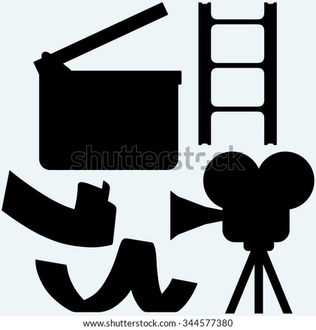 Cinematography. Video camera and film frame. Isolated on blue background. Raster silhouettes - stock photo