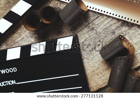 Cinematography. Vintage tape on the wooden table - stock photo