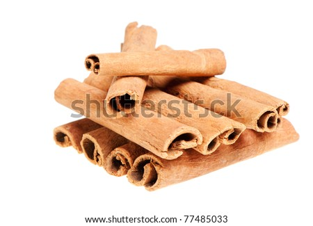 Cinnamon. A heap of sticks of cinnamon on a white background