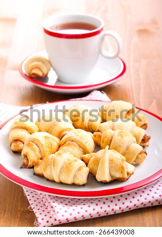 Cinnamon  and apple filling crescents and cup of tea - stock photo