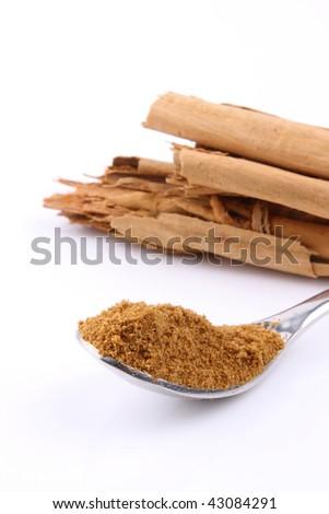 Cinnamon and cinnamon powder on a spoon - stock photo