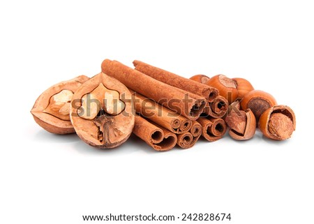 Cinnamon and nuts isolated on a white background