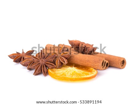 Cinnamon and oranges isolated on white background