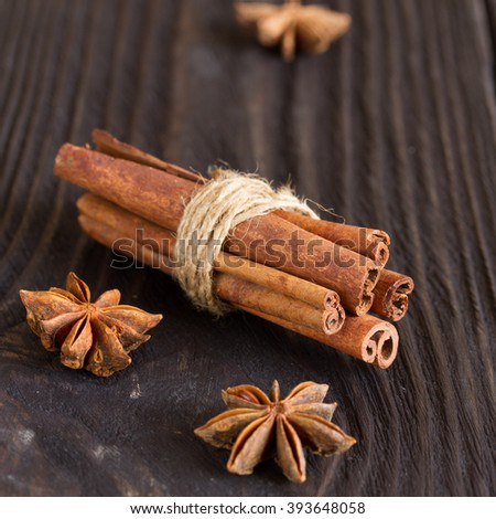 cinnamon and star anise on a wooden background . close-up.  - stock photo