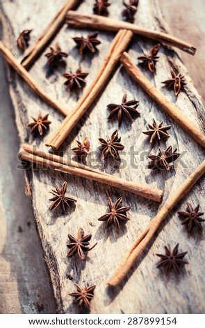 Cinnamon and star anise seeds on a wooden background. Bright still life photo of spices.