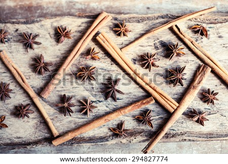 Cinnamon and star anise seeds on a wooden background - view from the top. Bright still life photo of spices.  - stock photo