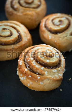 Cinnamon buns on rustic baking plate - stock photo