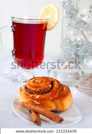 Cinnamon buns with hot drink. - stock photo