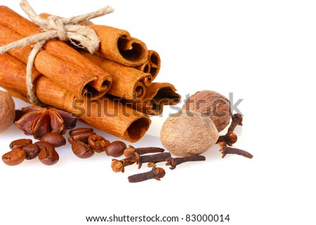 cinnamon, coffee and nutmeg isolated on white