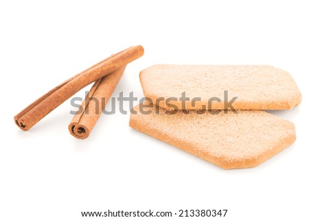 Cinnamon cookies and cinnamon sticks isolated on white background.