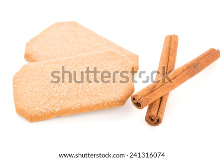 Cinnamon cookies and cinnamon sticks isolated on white background. - stock photo