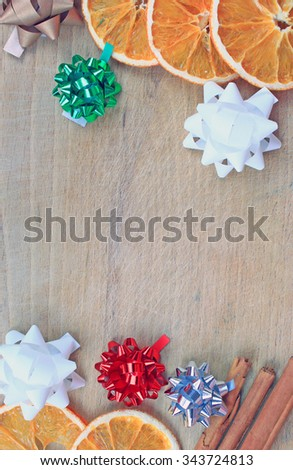 Cinnamon, decoration stars and slices orange over wooden background