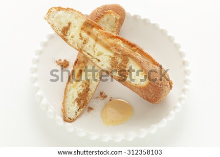 Cinnamon dought in half served with milk jam