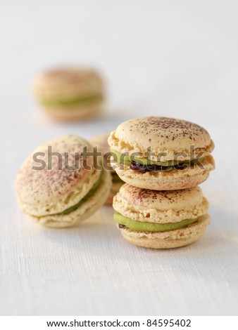 Cinnamon, griotte sour cherry and pistachio macaroons - stock photo
