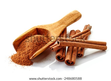 cinnamon ground and sticks isolated on a white background - stock photo
