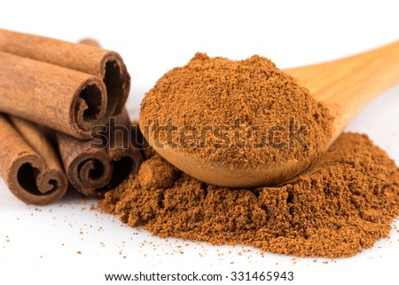 cinnamon ground and sticks isolated on a white background