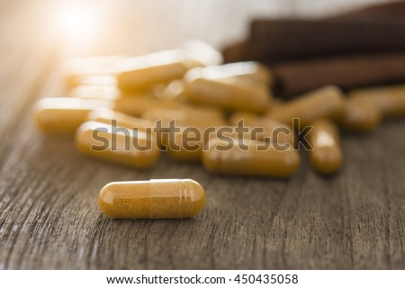 Cinnamon, herbs and spices, Herb capsule, Nutritional Supplement, Vitamin Pill, Herbal Medicine. - stock photo
