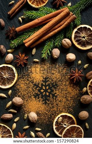 Cinnamon, nutmeg, star anise, cardamom and cloves. Christmas spices - stock photo