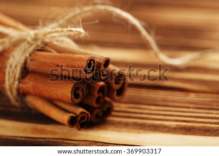 Cinnamon on a brown wooden background