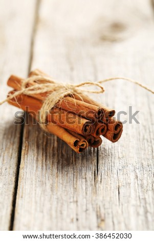 Cinnamon on a grey wooden background - stock photo