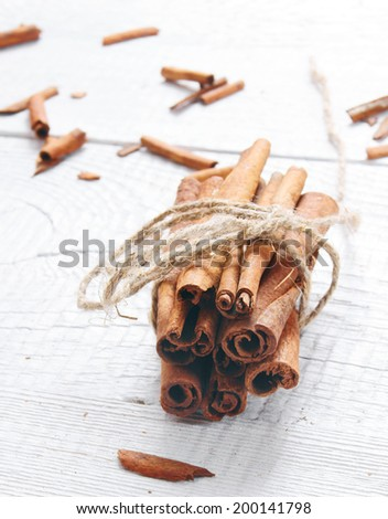 Cinnamon on a wooden background. - stock photo