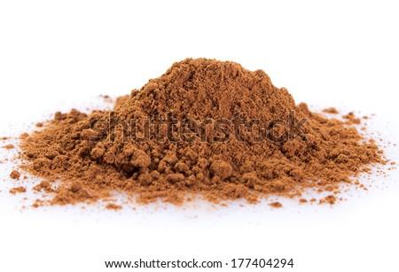 cinnamon powder isolated on white background - stock photo