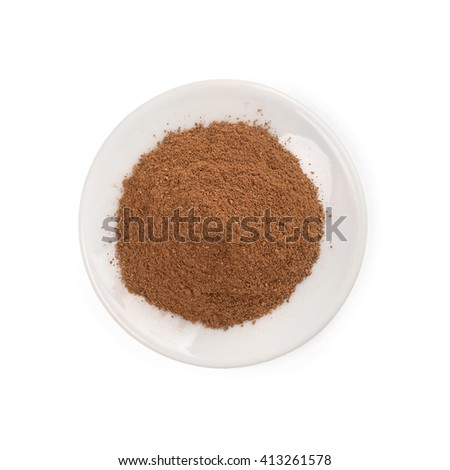 Cinnamon powder pile on white background - top view