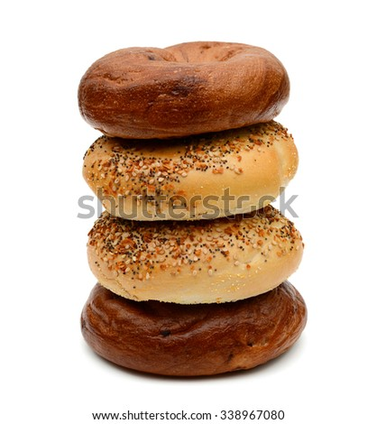 cinnamon raisin and sesame bagels isolated on white  - stock photo
