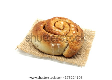 Cinnamon roll (also Coffee scroll, cinnamon bun, cinnamon swirl, cinnamon snail and kanelbulle in Sweden) isolated on white background - stock photo
