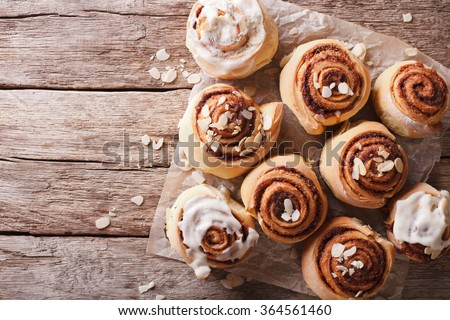 Cinnamon rolls with almond on the table. horizontal top view