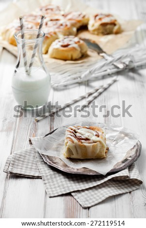 Cinnamon rolls with cream cheese icing - stock photo