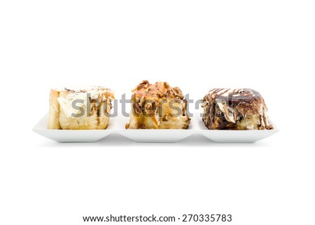 Cinnamon rolls with luxury topping on white background