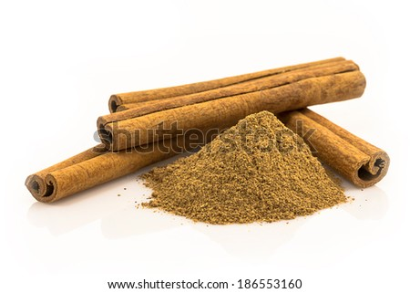 cinnamon spice - a powder and tube of dried bark - stock photo