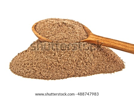 Cinnamon spice and wooden spoon isolated on a white background