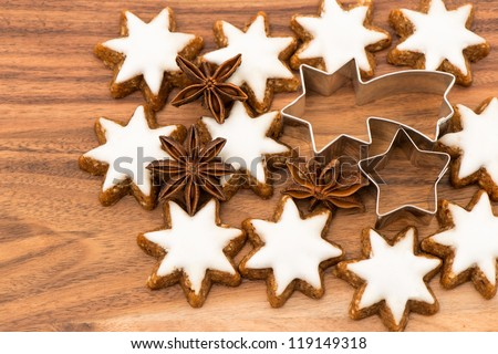 cinnamon stars and star anise on wooden background. christmas bakery - stock photo