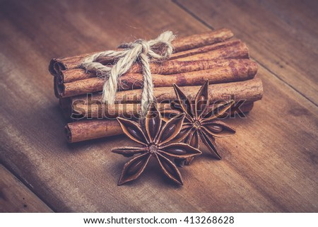 cinnamon stick and star anise on wooden table - stock photo