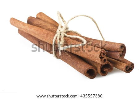 cinnamon stick spice close up on the white - stock photo