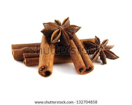 Cinnamon sticks and anise stars. Isolated on white background.