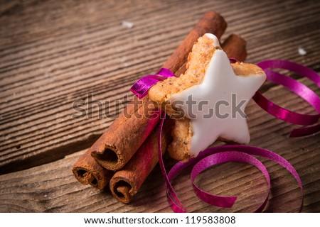 cinnamon sticks and Christmas cake - stock photo