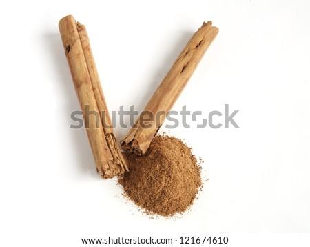 Cinnamon Sticks and cinnamon in powder. - stock photo