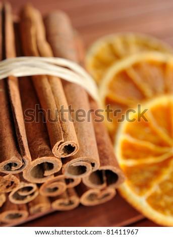Cinnamon sticks and dried orange cuts - stock photo