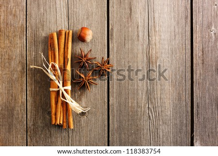 Cinnamon sticks and other spices over wooden table